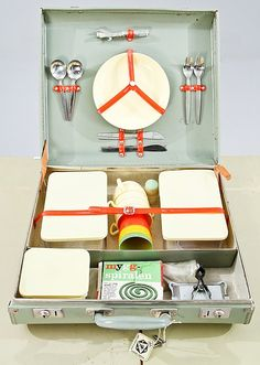 Vintage picnic set - this would be an interesting second function for a garment, straps could be added to any garment to hold cutlery and crockery.
