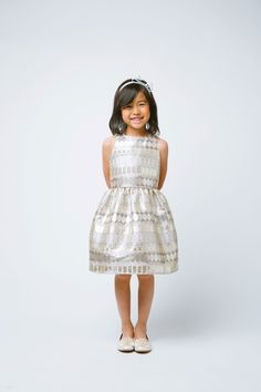 Girls Dress Style 594- Sleeveless Metallic Jacquard Dress in Choice of Color  We absolutely love the texture that Jacquard brings to dresses. This sleeveless jacquard dress has a stunning metallic design and is one that your little one can wear to so many events. This is sure to be a closest staple this season. You can dress up or down to your liking.  http://www.flowergirldressforless.com/mm5/merchant.mvc?Screen=PROD&Product_Code=SK_594CH&Store_Code=Flower-Girl&Category_Code=Taupe..