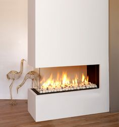 This is the style of log burning fireplace we're putting in the wall as you walk through from the living room to the kitchen and dining room...