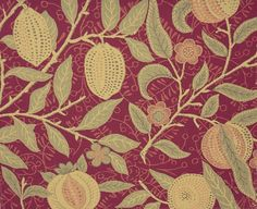 Fruit upholstery fabric design by William Morris. Tapestry-style fabric in green and gold on a crimson red ground