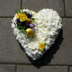 White based Heart with a yellow ribbon edge, and two floral sprays in yellows, purples, lime greens and greens. Funeral Flower Arrangements, Funeral Flowers, Florist London, Funeral Tributes, Flower Spray, Same Day Flower Delivery, Purple Flowers, Ribbon, Base