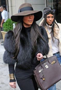 kim kardashian in a broad brimmed hat - // fall fashion // hermes // fur // hat.