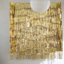 Photobooth backdrop made of gold streamers!