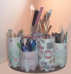 Here are some great ideas for crafts made from recycled items. Use these instructions to make a Water Bottle Supply Organizer Recycled Craft, an easy way to organize your crafting supplies with water bottles and other recycled items! Uses For Plastic Bottles, Recycled Bottles, Empty Water Bottles, Bottle Candles, Recycled Glass, Upcycled Crafts, Easy Crafts, Easy Diy, Water Bottle Crafts