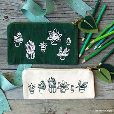 With just a simple iron-on, we turned these ordinary canvas pouches into gorgeous botanical pencil bags. Follow our tutorial to make them for yourself!