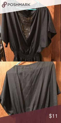 Black short sleeve blouse Black Calvin Klein blouse w/ metal look decoration on front.(one of the decorations need to be attached) Calvin Klein Jeans Tops Blouses