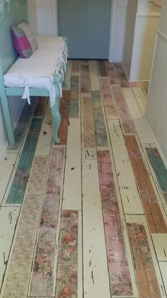 Repurposed laminate flooring.  Painted, decoupaged and sealed!