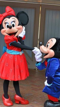 Mickey kissing Minnie's hand and it just made her blush.