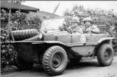 "A Lieutenant behind the wheel of his ""Bad Bastard"", a captuerd German Schwimmwagen."