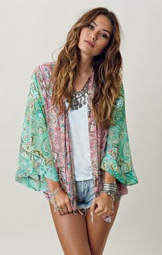 Boho chic.  Love the kimono and necklace...needs longer bottoms, though!