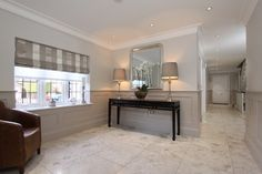 Heritage Panelling contemporary hall   The Wall Panelling Company The Panelling is painted in Elephants Breath and the walls above are painted in Skimming Stone, both paint colours available from Farrow & Ball.