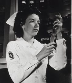 Images from the History of Medicine (NLM): A Cadet Nurse in hospital uniform fills a syringe