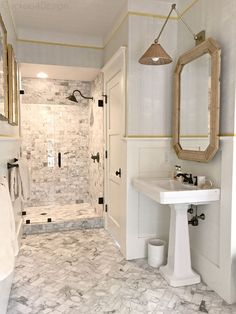 marble master bathroom and wicker rattan accents