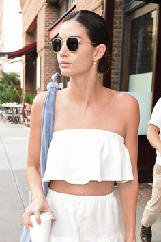 Lily Aldridge relied on a sleek knot and sunglasses to give her no-makeup makeup a city-ready edge.