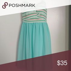 Strapless party dress Zip up back with pastel stripes on bust and an aqua skirt. Perfect for bridesmaid or wedding guest outfit. Worn once. Fits size 6-8 listed as 11/12. Ask for measurements Dresses