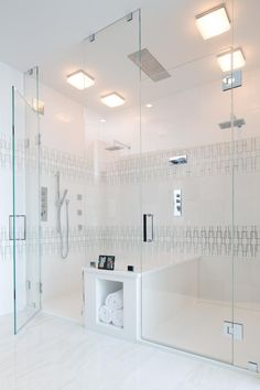 This luxurious walk-in shower can fit two at a time—with a center bench in between—both sides with ceiling mount rain heads and waterfall massages from Aquabrass. Rounding out the spa experience is the shower's Aqua Music shower system with built-in shower speakers.