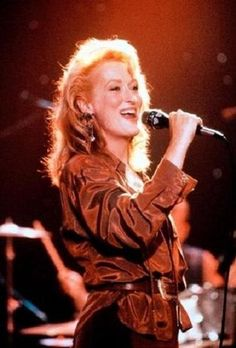 """""""Postcards from the edge"""" (1990). She's amazing at the last scene where she sings """" I'm checking out """""""