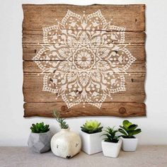 Passion Mandala Stencil is an intricate pattern from Cutting Edge Stencils painted on wooden wall art. http://www.cuttingedgestencils.com/passion-mandala-stencil-yoga-decal-wall-stencils-mandalas.html