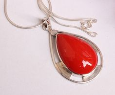 An artisan gemstone pendant Coral necklace. This beautiful Pendant is made of Red bamboo coral and handcrafted secure bezel setting in fine sterling silver .A very versatile gemstone goes with every thing , every season. Can make this design with any gemstone..Wear it love it .Proud indie artisan jewelry. Hope you love my original creations, One of a kind :) Great as gifts too... Enjoy!  The chain measures: 16.5 inches, Pendant stone,Red bamboo coral, 29x20 mm, total 2 inch. Metal: Fine 92.5…