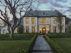 Positioned on an interior lot with majestic trees, this beautiful French-design Preston Hollow home has been extensively customized with sophisticated, classic finishes. The flagstone approach leads to a Leuders stone exterior highlighted by cast stone, leaded copper dormers and finials. Inside the residence, beautiful hardwood flooring and an abundance of natural light create a fresh feel throughout the rooms. A wall of windows in the gourmet kitchen and breakfast area bathes the rooms in…