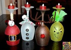 Wine glass character candle holders. Dollar store wine glasses with glitter blast spray paint.  Super cute!!