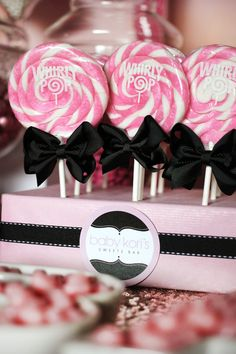 DISPLAY IDEAS: When ordering lollipops that come with a display box, glam it up with papers, bows, ribbon, etc. This one is just black ribbon added to the swirl lollipops to decorate their display cartons. Barbie Birthday, Barbie Party, Candy Table, Candy Buffet, First Birthday Parties, First Birthdays, Birthday Ideas, Happy Birthday, Lollipop Display