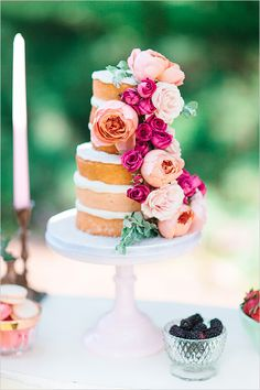Naked wedding cake with flowers.