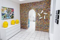 Think you're a LEGO whiz kid? A few determined chaps at a Hamburg, Germany company (NPIRI) spent a solid year putting together the LEGO wall you see above. In total there are over individual LEGO pieces making for the ultimate nerd wall. Lego Design, Legos, Deco Lego, Van Lego, Lego Wall, Diy Room Divider, Room Dividers, Divider Ideas, Divider Design