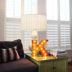 Plantation shutters for den w/ the upper part adjustable different from the lower.