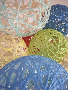 cool balls to hang from tree or ceiling made of yarn and balloons and glue then spraypainted....