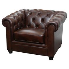 Wrapped in richly hued leather upholstery, this Chesterfield-inspired arm chair adds a touch of handsome style to your living room or den.    ...