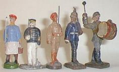 Toy soldier - Composition Figures. More smaller scale composition figures, the first a zoo keeper by ELASTOLIN, next a Japanese naval officer (manufacture unknown) which came with tinplate battleships commemorating the Battle of the Tsushima Straits in 1904. The Sikh infantryman marching is by ELASTOLIN while the Prussian in pickelhaube and bass drummer are by LINEOL.