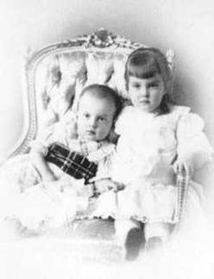 With her younger brother Dmitri.  Their mother died giving birth to him and their father was exiled for marrying a divorcee.