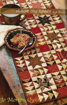 This quilt was in 'Skinny Quilts and tablerunners II' in 2009 by That Patchwork Place. Yummy colors.