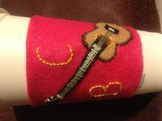 Another coffee sleeve made of felt and embroidered.