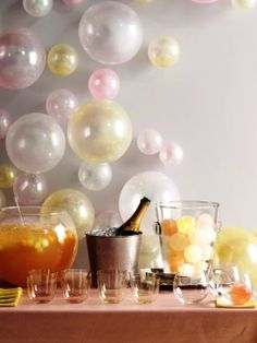 Champagne colors elevate simple balloons to adult decoration status.   ciao! newport beach: New Year's Eve Fun