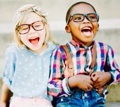 Laughing Young Children in Glasses.