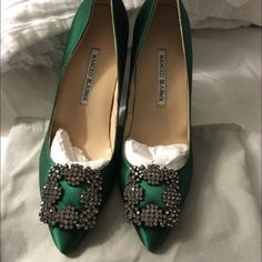Green MANOLO BLAHNIK Size 7 Brand New Green Satin Pumps.. ONLY ONE PAIR LEFT! Everything I'm selling is sold in lower priced.. I can sell it to Merc for lower price.. Let me know.. Manolo Blahnik Shoes Heels