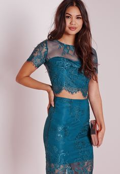 Channel dreamy vibes into your style with this chic lace crop top. Featuring a delicate teal lace overlay, this feminine piece will lift your look in an instant. Team with the matching midi skirt and barely there heels for effortless stylin...