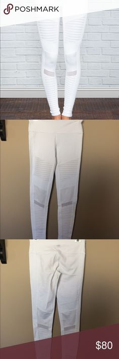 Alo Yoga High Waist Moto legging These are the coolest looking leggings. They fit great and are comfortable. These are brand new, worn only once. I did remove the tag but I remember that the size is medium. ALO Yoga Pants Leggings