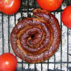 This spiral-shaped sausage is a popular braai (barbecue) meat in South Africa. Made with beef and pork and flavored with coriander and vinegar, boerewors has its roots in the Netherlands. South African Dishes, South African Recipes, Homemade Sausage Recipes, Beef Recipes, Hot Dogs, Farmer Sausage, International Recipes, Carne, A Food