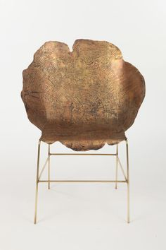 Acid etched metal chair by Sharon Sides