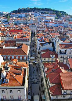 7 Days in Portugal Itinerary | View of the Baixa district of Lisbon with Castelo São Jorge in the distance.