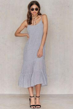 This is going to be a must-have for this upcoming season! The Caria Dress by Minimum comes in the color steel grey and features a square neck with thin straps, midi length, pleated fabric with tiered ruffle details. Style with sunnies and put your favorite sandals on and shine!