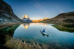 Photo @chrisburkard // Lake Riffelsee dwells in a small valley just South of the town of Zermatt Switzerland. The Matterhorn is such a dominant peak on the horizon its not difficult to discover incredible views of this behemoth from practically every angle. The valley glows green during the Summer and with a myriad of ways to explore from mountain bike to paragliding its an adventurers perfect getaway. by natgeotravel