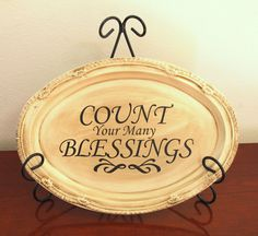 How to make a beautiful antiqued plaque from a dollar store tray. Cheap and easy home decor!