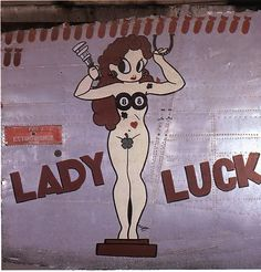 """""""Lady Luck"""" from the Confederate Air Force Collection.  This collection of nose art panels came to the CAF from Minot Pratt, the general manager of the company that was scrapping planes at the boneyard at Walnut Ridge, Arkansas.  He had ordered his men to cut out and save the most interesting nose art, which he was supposedly going to put up as a fence around his property.  This never happened and he donated the pieces to the CAF in the 1960's."""
