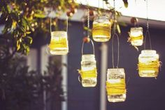 hanging mason jars with watee colo you want to tie in the wedding. you can always borrow jars from friends and retun later. What a cheap and creative way to go!