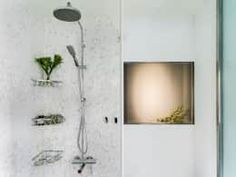 White tiles and glowing alcoves make this a unique bathroom.  Modern Bathroom by 鄭士傑室內設計