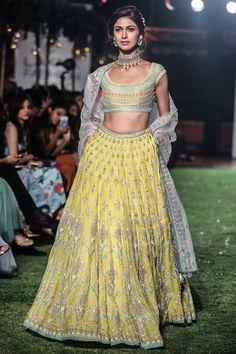 ANITA DONGRE Yellow Embroidered Lehenga Set. Shop Now! #anitadogre #yellow #floral #embroidered #lehenga #brocade #chanderi #lfw18 #straightfromrunway #indianfashion #indiandesigners #perniaspopupshop #happyshopping